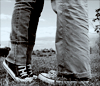 chucks kissing in the field