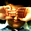 Dean rubbing eyes