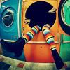 girl washing machine stripey rainbow