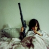 bed and gun