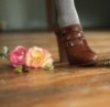 brown shoes and flowers