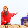 amy in the sand with TARDIS