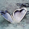 STOCK - heart locket in the sand