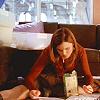 Bones Brennan on floor eating reading ca