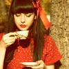 Red girl drinking tea