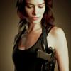 Becka: chick with gun