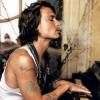 Johnny Depp plays the piano