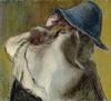 жінка в капелюсі