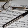 pens paper glasses