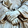 hands clasped in marble