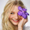 smiling with purple flower