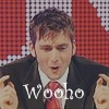 DT says wooho in black suit