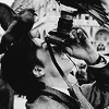 alain delon with a pidgeon on his head