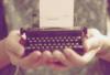 Typewriter in hand