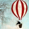 A striped hot air balloon going up in th