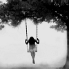 alone on a swing