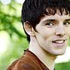 Merlin's smile over the shoulder