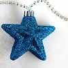 [image description: blue, glittery ornament]