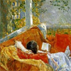 reading on a couch