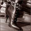 BUT HARRY STYLES: boot and chain