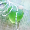 green bottle and pearls