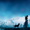 silhouetted woman and dog amongst misty blue mountains background