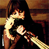 » kenzi; smelling flowers.