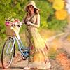 Kimmy: woman bicycle basket flowers