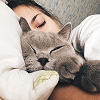 girl ≡ laying with cat