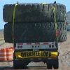huge tires on flatbed trailer