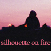 silhouette on fire