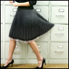 Pouncer: Pleated skirt and heels