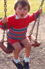 young jamie on swing