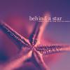 behind a star