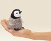 a very caring potato: a penguin in the hand