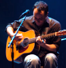 dave sitting guitar