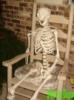 skeleton in chair.