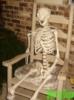 skeleton in chair.