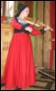medieval woman in red dress playing viol