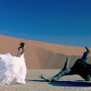 cutting_rm_flr: Cell-White dress in desert
