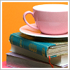 Pink cup and books