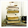 Spackle: stack of books and also tea
