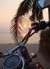 Мотоцикл на закате у моря зимой