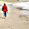 Walk along the beach, pensive