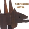 tarnished metal dinosaur