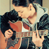marina: playing the guiter