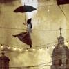tightrope with umbrella