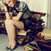 Emma Watson - Sitting on Books