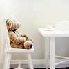 happy is as happy does: teddy bear in chair
