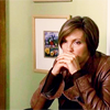 Detective Olivia Benson: hands brown leather jacket